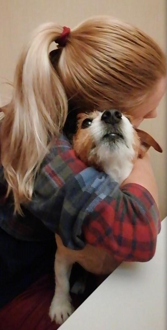 Depressed Woman Hugging Her Cute Dog For Comfort
